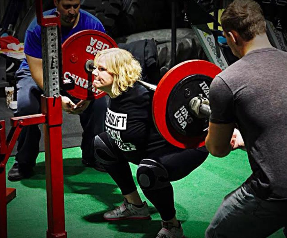Angela Marshall performing a backsquat, doing CrossFit in Anchorage, Alaska.